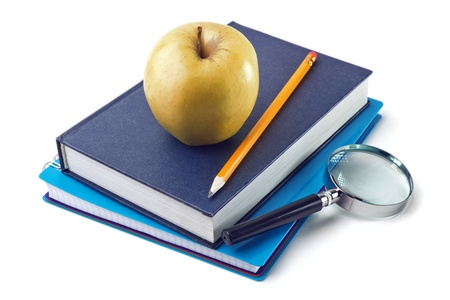Notebook and apple isolated on a white background photo