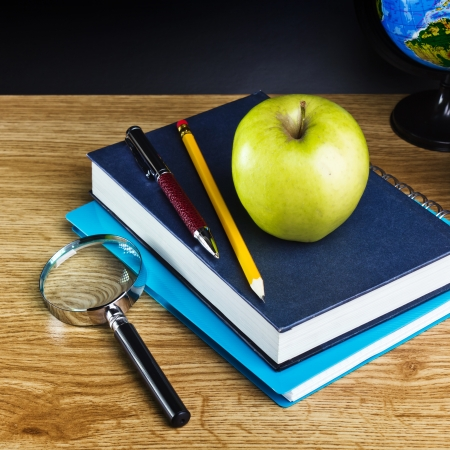 new school year: Teachers desk with a color pencil, notebook and other equipment.