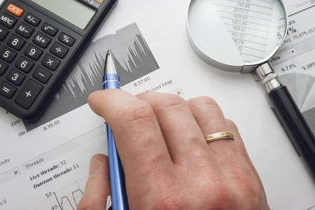 soft tip pen: Close-up of specialist checking a financial analyze Stock Photo