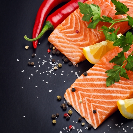 sea food: Fresh salmon on black plate Stock Photo