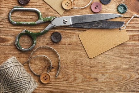 Old scissors and buttons on the wooden table Stock Photo - 20056348