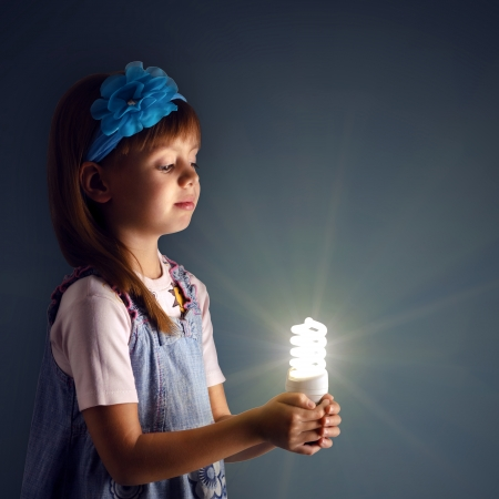 lit lamp: Little girl with a lit lamp in hand Stock Photo