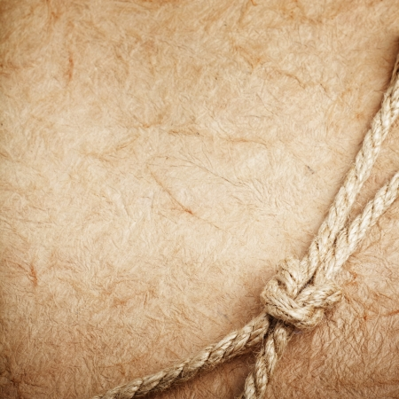 old paper with rope photo