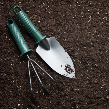 Close-up of the organic soil and spade Stock Photo
