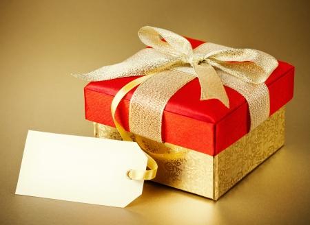 Christmas gift box on gold background photo