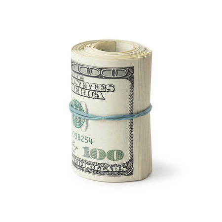 abundance money: One roll from dollars on white background Stock Photo