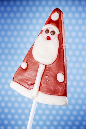 Christmas lollipop isolated on blue background photo
