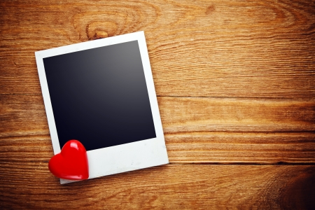 Blank instant photo and small red heart on old wood Stock Photo - 25303601