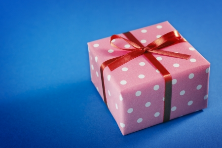 Small Handmade gift boxes on blue background photo