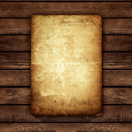 discolored: Old paper on the wood background Stock Photo