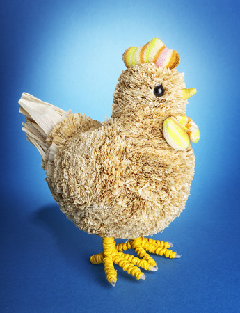 Handmade chicken on blue background photo