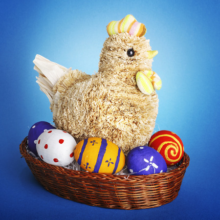 chiken: Handmade chicken wiht Easter eggs on blue background