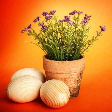 Wooden Easter eggs on orange background/ Easter holidays background  photo