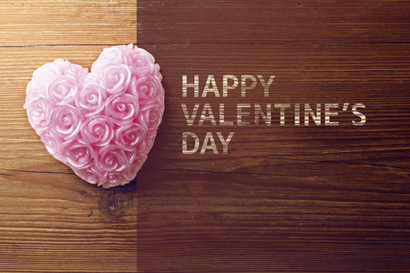 Old wooden background with heart shape photo