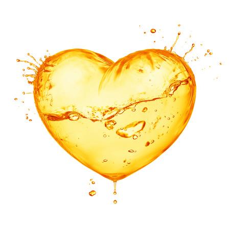 Heart from orange splash with wave, inside isolated on white photo