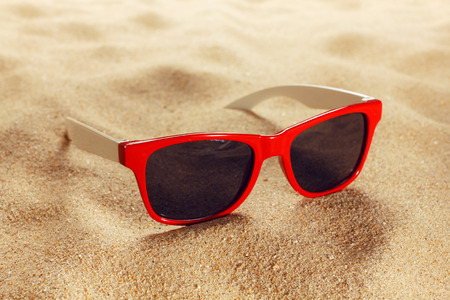 Sunglasses on the beach photo