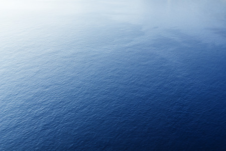 with ocean: Blue tropical sea surface with waves and ripples. View from plane Stock Photo