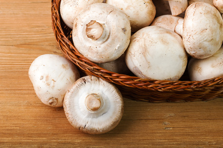 rustical: Champignon on wooden background Stock Photo