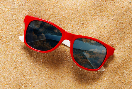 Reflecting sunglasses on the beach photo