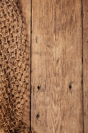 Hanging Fishnet on Wood Wall photo
