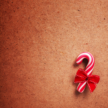 x mas: candy canes on weathered wooden board Stock Photo