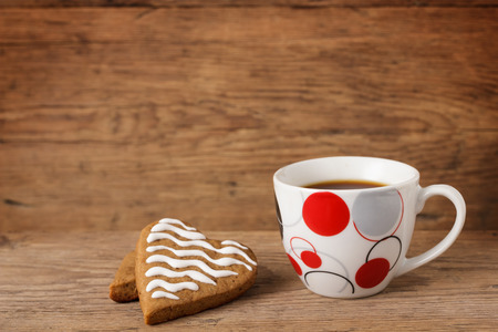 comfits: Heart shaped cookie with a cup of coffee Stock Photo