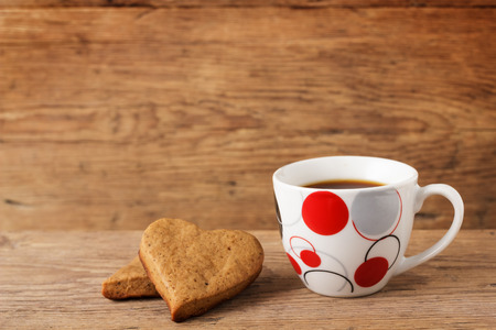 comfits: Hearts and coffee on a wooden background