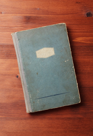 old notebook: book on wooden board