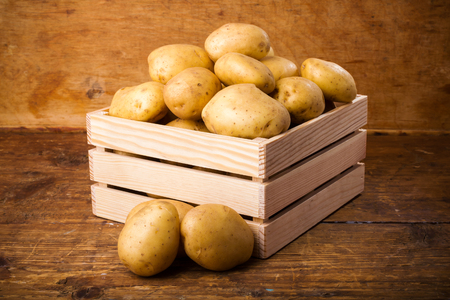 potatoes: Potatoes in a wooden box Stock Photo