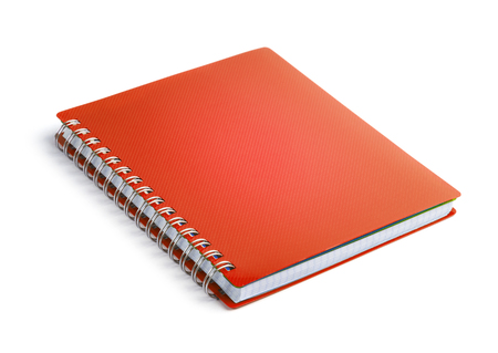 Red closed paper notepad isolated on white background
