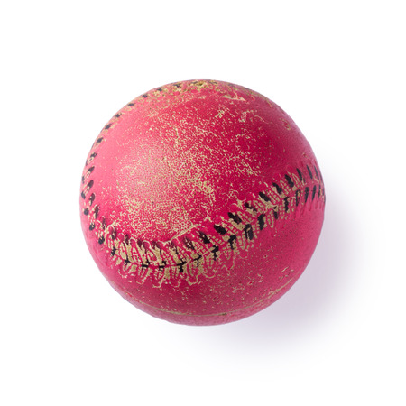 red leather: A used red leather cricket ball on a white isolated background