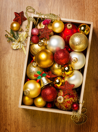 Colored Christmas balls in a wooden box