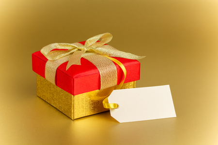 Gift box in gold wrapping paper