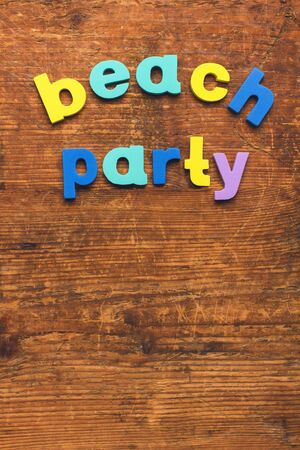 Beach party - letters on the wood board.