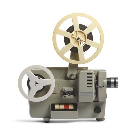 Old cinema projector isolated on white background
