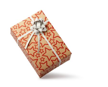 Wrapped gift box with ribbon bow, isolated on white background. Christmas, New Year, Valentines Day present. 免版税图像