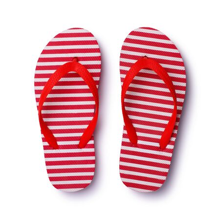 Beach rubber footwear isolated on white background. Summer plastic flip flops for travel.