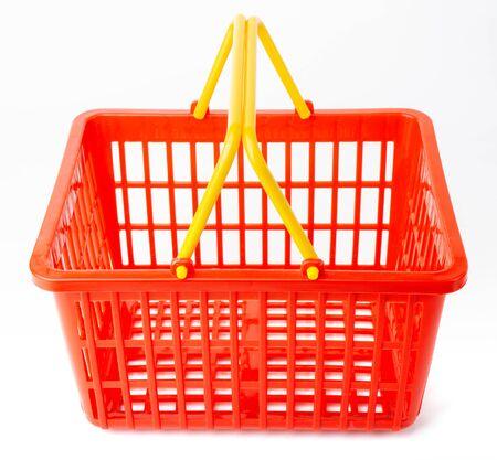 Plastic shopping basket on white background