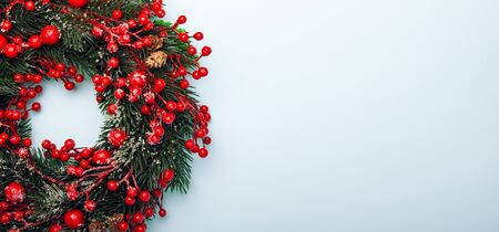 Top view of traditional Christmas wreath with copy space.