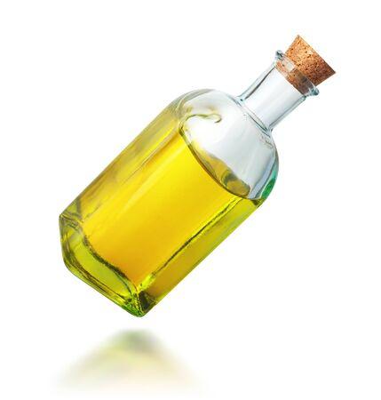 Oil in a bottle on white. Oil splash. Path included.  免版税图像