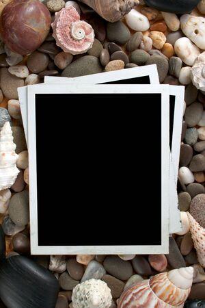 Retro photo framework against an sea stone and shell