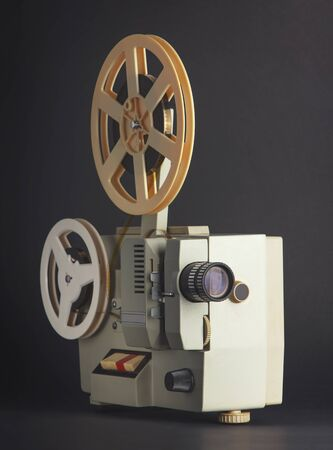 Old cinema projector isolated on black background
