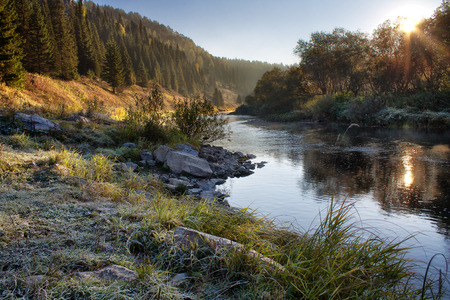 Autumn landscape on the mountain river with rime Stock Photo