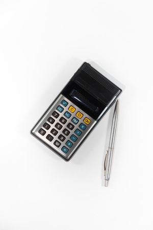 sums: Old calculator and pen isolate on white background