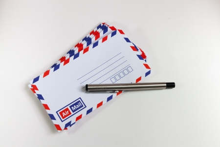 Envelope and pen aare in white background photo