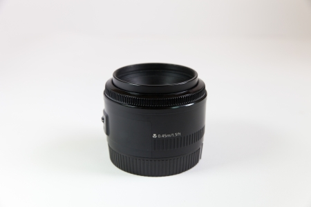 Black lens on a white background photo