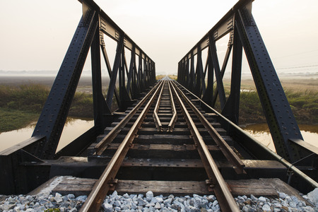 Old railway viaduct in Thailand photo