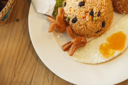 Fried rice with egg and hotdog photo