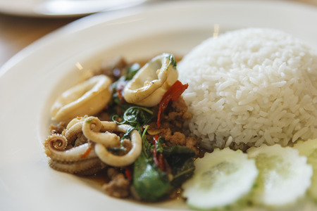topped: Rice topped with stir-fried basil