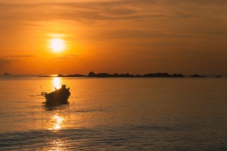 Fisherman boat with sunset scene in koh phangan, Surat Thani, Thailand